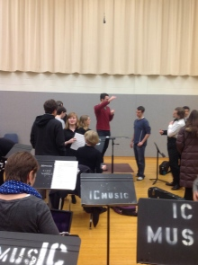 Journey composer Austin Wintory talks to the ensemble after meeting with them March 2.